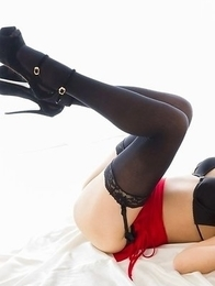 Natsuki Yokoyama takes off her red and black get-up before working on that cock