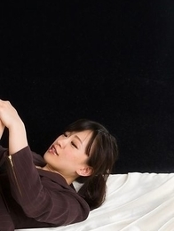 Strict-looking seductress Yui Kyouno gives this dude a scintillating footjob in HQ