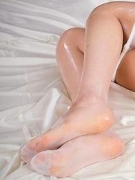 Pantyhose-wearing Japanese slut Moeka Kurihara masturbating in a solo gallery
