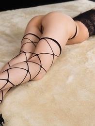Fishnets-wearing brunette in heels Ayaka Mikami posing shamelessly on the floor