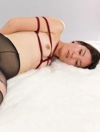 Madoka Yukishiro wearing a pantyhose during a deeply arousing thigh fucking session