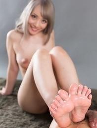 Busty blonde Airi Mashiro giving a phenomenal footjob after a quick masturbation