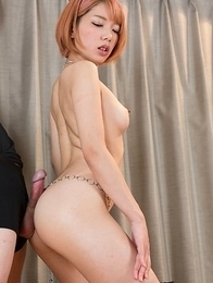 Redheaded beauty Chie Kobayashi lets a guy rub his cock against her oily ass