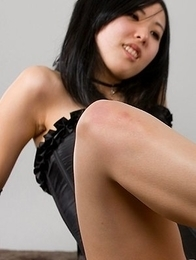 Corset-clad domme Natsuki Yokoyama uses her perfect feet to get him off