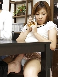 Hot Hitomi Okubo has pussy rubbed under table