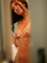 Sayaka Ando is very erotic playing with shower over clothes