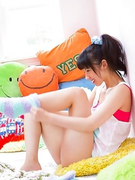Rina Koike in socks and colorful bath suit is so playful