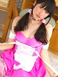 Tomoe Yamanaka in pink maid uniform plays with teddy bea