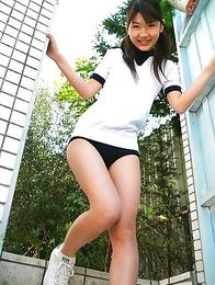 Noriko Kijima in sports equipment is playful in the house