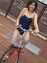 Ageha Yagyu in spandex bath suit shows curves on bike