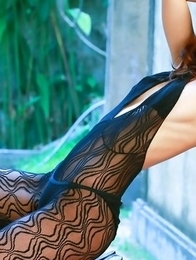 Saki Yamaguchi in lace outfit shows hot curves at window